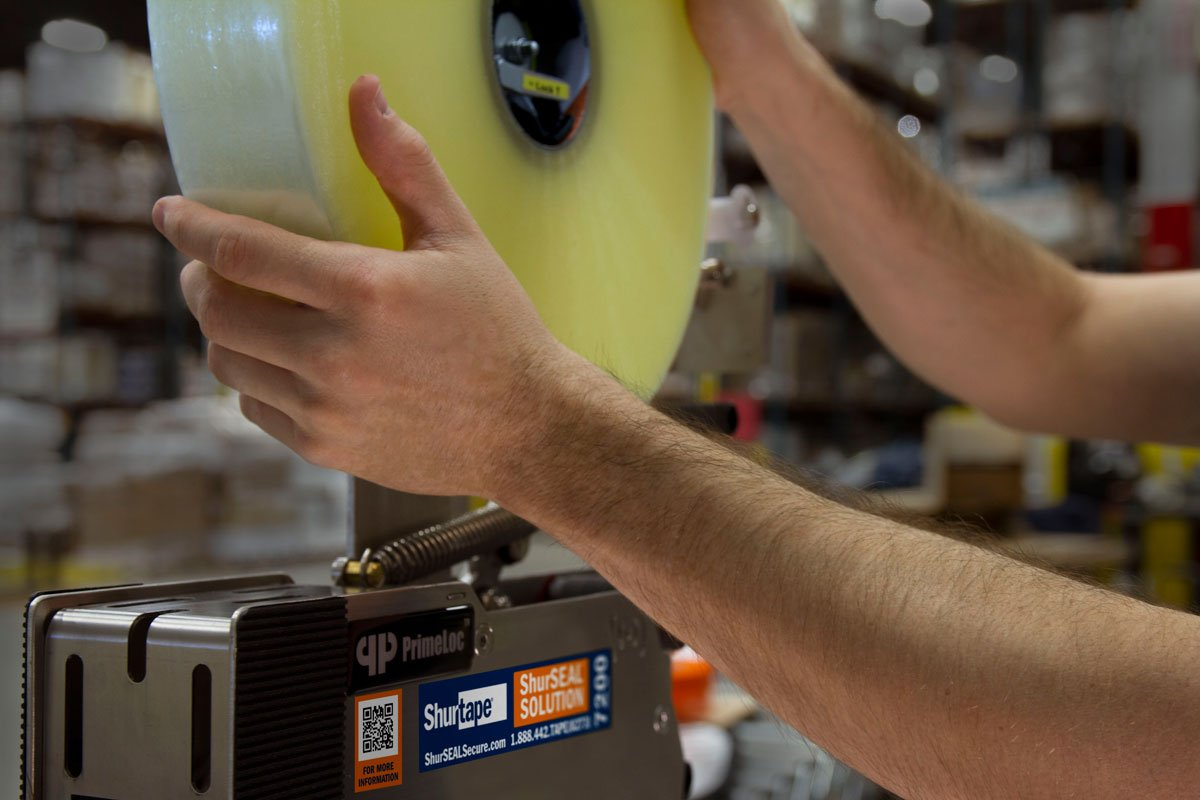 Loading tape into SP 7000 Tape Head.